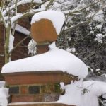 A snow covered finial in Bedford Park.